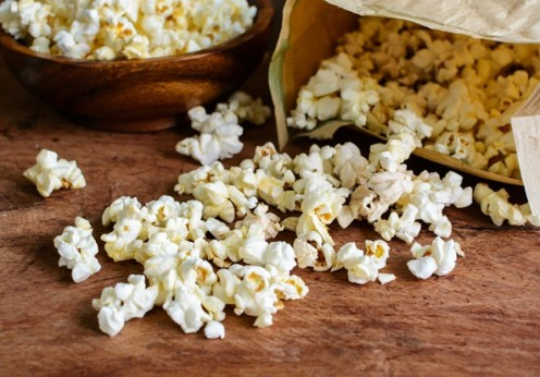 52913894 - popcorn on wooden table