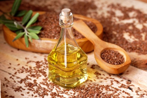 38728741 - essential oil of linseed in the small glass bottle