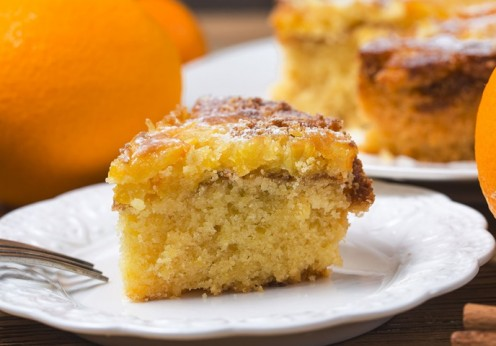 84277609 - orange cake on the wooden background