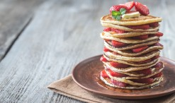 80156290 - stack of pancakes with fresh strawberries on the plate